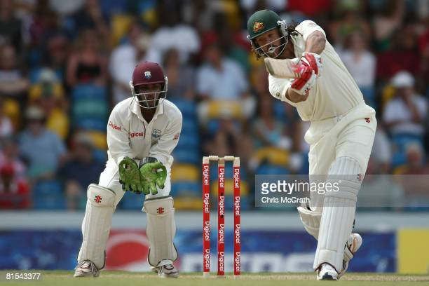 Andrew Symonds of Australia plays a shot during day one of the third test match between the West Indies and Australia at Kensington Oval on June 12...