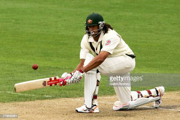 Andrew Symonds of Australia plays a sweep shot during day two of the Second test match between Australia and Sri Lanka at Bellrevie Oval November 17...