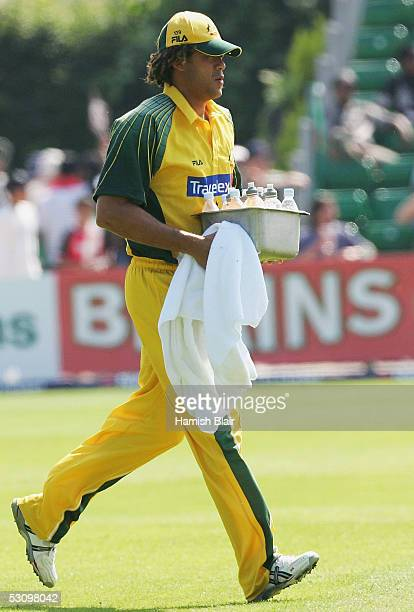 Andrew Symonds of Australia, who was excluded from the team for breaching team rules, carrys drinks on to the field during the NatWest Series One Day...
