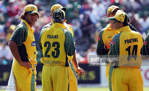 Andrew Symonds of Australia who was excluded from the team for breaching team rules serves drinks to team mates during a break in play during the...