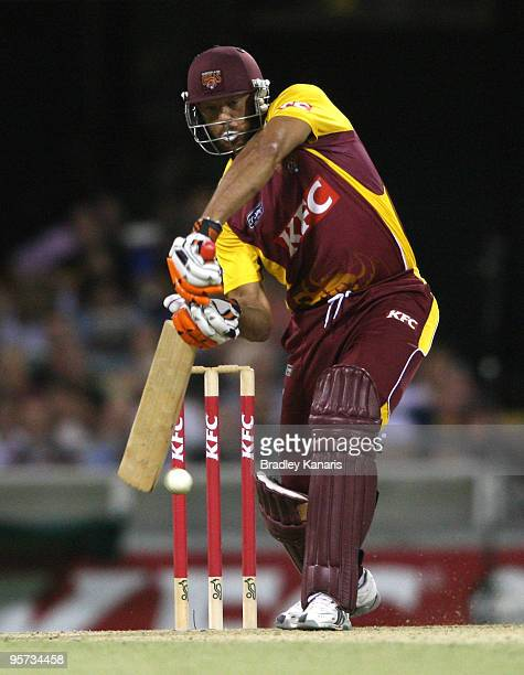 Andrew Symonds of the Bulls drives during the Twenty20 Big Bash match between the Queensland Bulls and the Tasmanian Tigers at The Gabba on January 8...