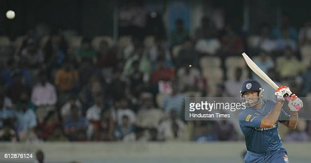 Andrew Symonds of the Deccan Chargers hits the ball towards the boundary during the Airtel Champions League Twenty20 Group A match between the Deccan...