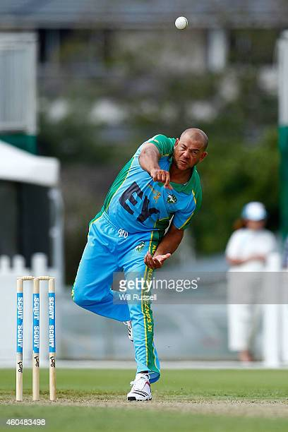 Andrew Symonds of the Legends XI bowls during the Twenty20 match between the Perth Scorchers and Australian Legends at Aquinas College on December 15...