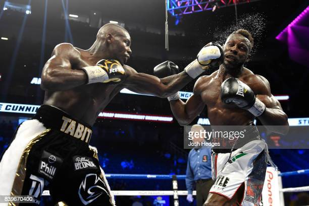 Andrew Tabiti throws a punch at Steve Cunningham during their cruiserweight bout on August 26 2017 at TMobile Arena in Las Vegas Nevada