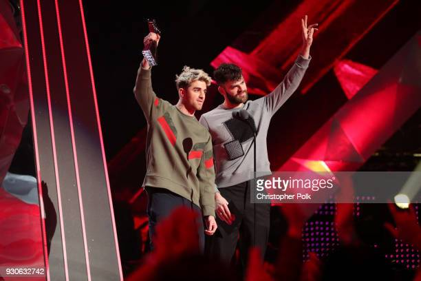 Andrew Taggart and Alex Pall of The Chainsmokers accept Best Collaboration for 'Something Just Like This' onstage during the 2018 iHeartRadio Music...