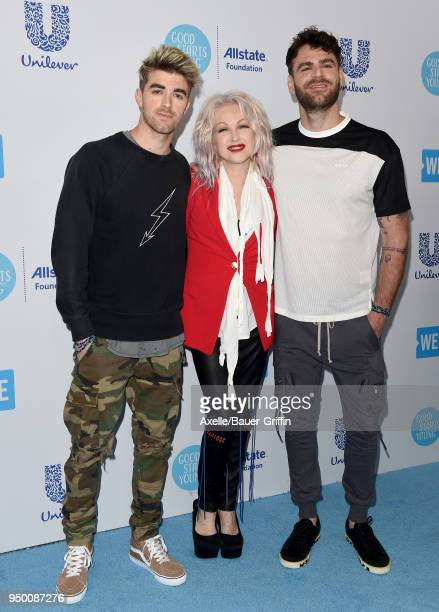 Andrew Taggart and Alex Pall of The Chainsmokers and Cyndi Lauper attend WE Day California at The Forum on April 19 2018 in Inglewood California