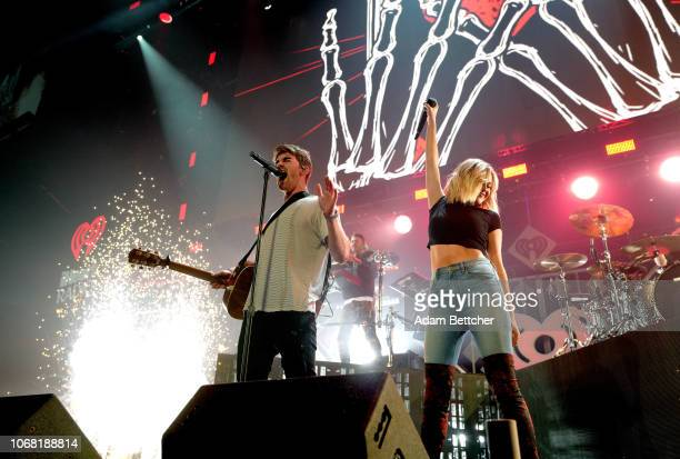 Andrew Taggart and Alex Pall of The Chainsmokers and Kelsea Ballerini perform onstage during 1013 KDWB's Jingle Ball 2018 at Xcel Energy Center on...