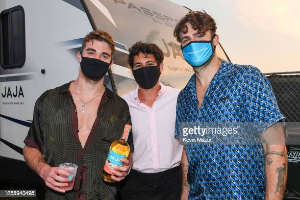 Andrew Taggart and Alex Pall of The Chainsmokers pose with guests backstage during the 'Safe & Sound' Drive-In Concert Fundraiser Presented by JAJA...