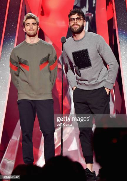 Andrew Taggart and Alex Pall of The Chainsmokers speak onstage during the 2018 iHeartRadio Music Awards which broadcasted live on TBS TNT and truTV...
