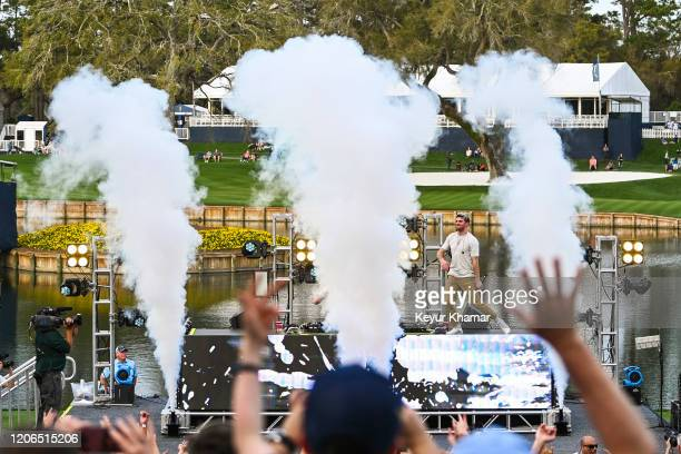 Andrew Taggart of The Chainsmokers dances on stage as they perform during the Military Appreciation Day Ceremony and Concert for THE PLAYERS...