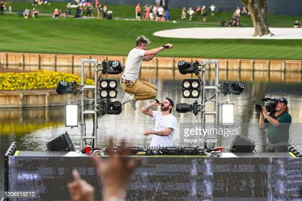Andrew Taggart of The Chainsmokers jumps off the stage as they perform during the Military Appreciation Day Ceremony and Concert for THE PLAYERS...