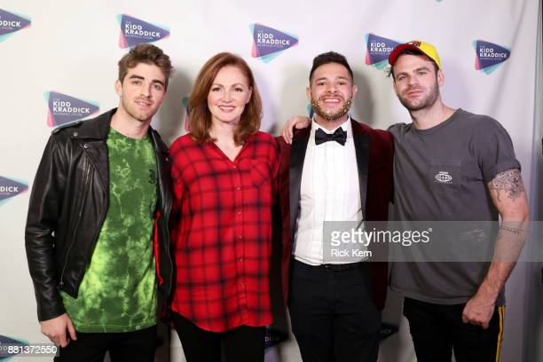 Andrew Taggart of The Chainsmokers radio personality Kellie Rasberry radio personality PartTime Justin and Alex Pall of The Chainsmokers attend 1061...