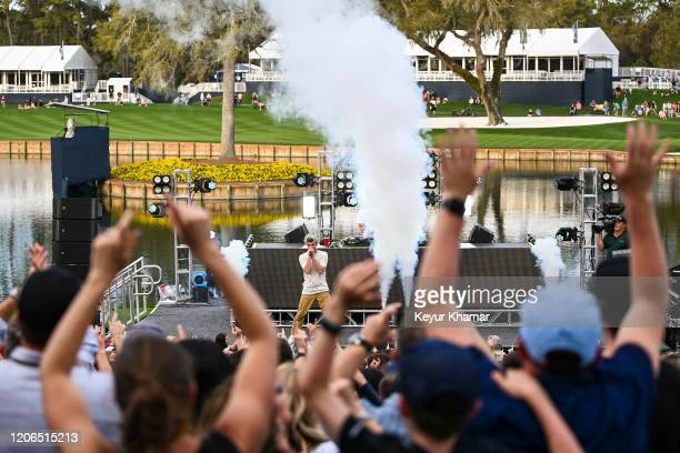 Andrew Taggart of The Chainsmokers sings as they perform during the Military Appreciation Day Ceremony and Concert for THE PLAYERS Championship on...