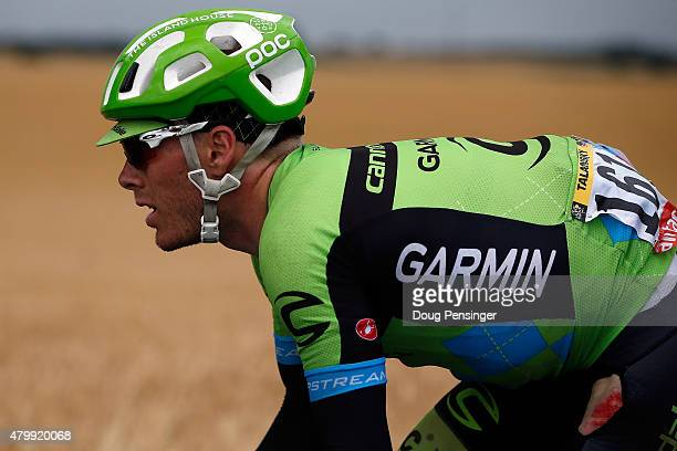 Andrew Talanksy of the United States riding for Cannondale-Garmin exhibits evidence of a crash as he chases at the back of the race during stage five...