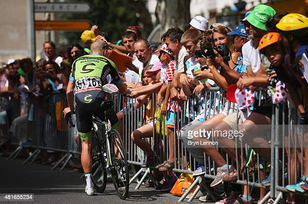 Andrew Talansky of the United States and Team Cannondale-Garmin signs autographs ahead of Stage Eighteen of the 2015 Tour de France, a 186.5km stage...