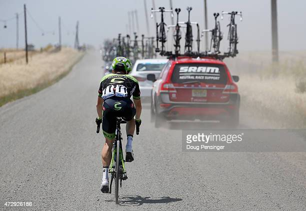 Andrew Talansky riding for Team Cannondale-Garmin falls off the back of the race as they pass through a dirt and gravel road during stage one of the...