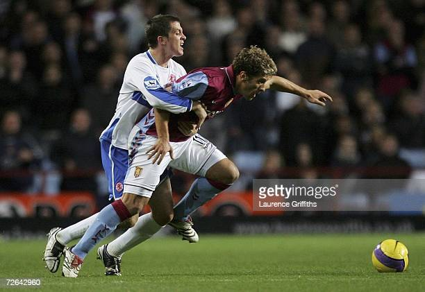 Andrew Taylor of Middlesbrough battles with Stiliyan Petrov of Villa during the Barclays Premiership match between Aston Villa and Middlesbrough at...