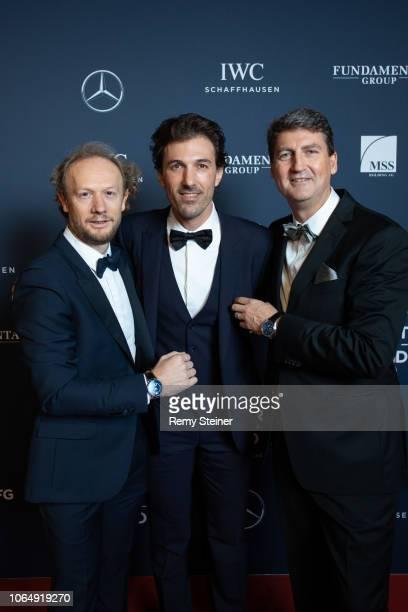 Andrew Thomas, Fabian Cancellara and Managing Director IWC Switzerland Linus Fuchs attend the 12th Laureus Charity Night at Hangar Duebendorf near...