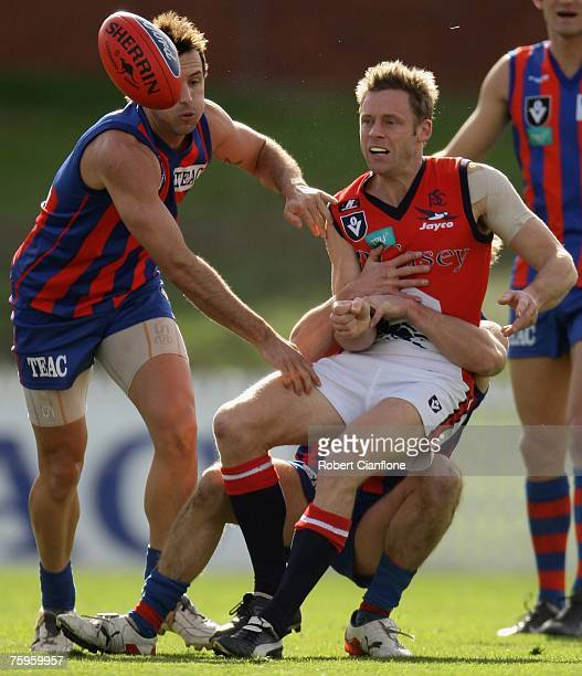 Andrew Thompson of the Scorpions is challenged by his opponent during the round 17 VFL match between Port Melbourne and the Casey Scorpions at TEAC...