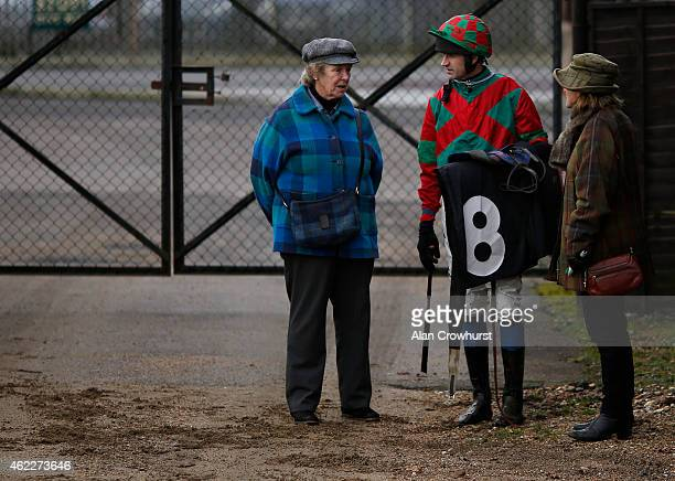 Andrew Thornton chats with connections at Plumpton racecourse on January 26 2015 in Plumpton England