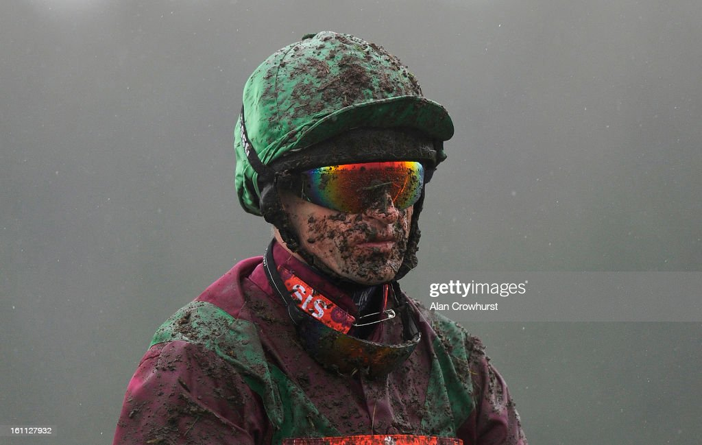 Andrew Thornton is pictured covered in mud at Newbury racecourse on February 09, 2013 in Newbury, England.
