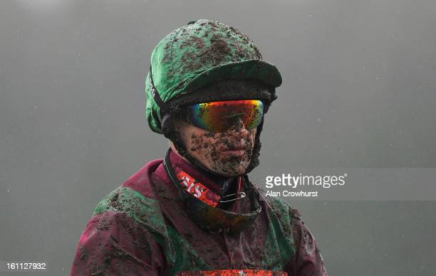 Andrew Thornton is pictured covered in mud at Newbury racecourse on February 09 2013 in Newbury England