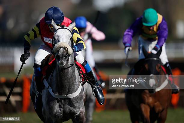 Andrew Thornton riding Ultimate Act clear the last to win The William Hill Mobile Cheltenham Offers Juvenile Handicap Hurdle Race at Sandown...