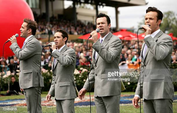 Andrew Tierney Phil Burton Michael Tierney and Toby Allen of Human Nature sing the national anthem before the start of The Emirates Melbourne Cup...