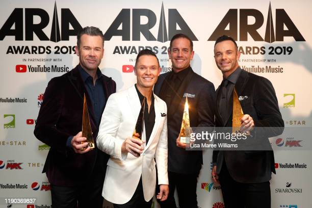 Andrew Tierney Toby Allen Michael Tierney and Phil Burton of Human Nature pose in the awards room after being inducted into the ARIA Hall of Fame...