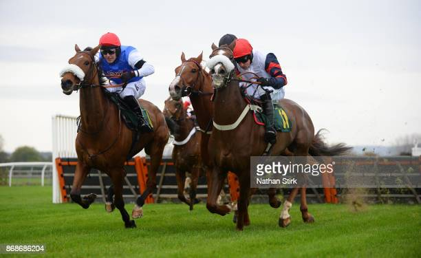 Andrew Tinkler rides Wedmore and Harry Skelton rides Zalvados during The HN Nuttall LTD Novices Hurdle Race at BangorOnDee Racecourse on October 31...