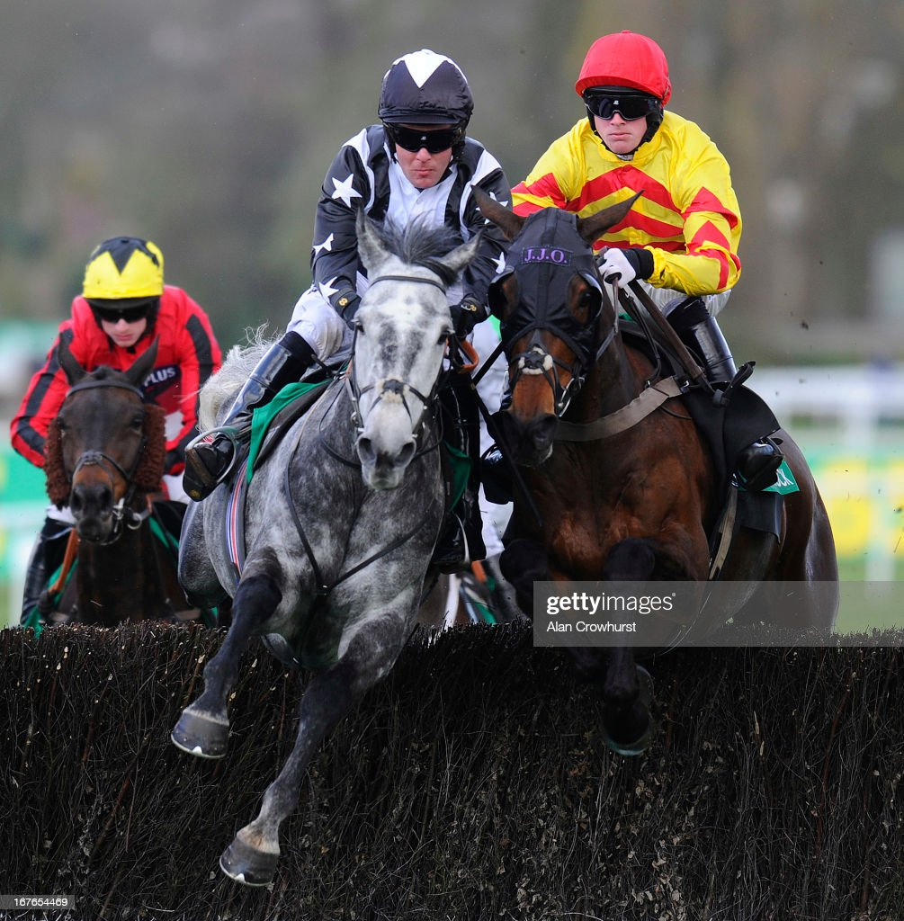 Andrew Tinkler riding Quentin Collonges (2L) on their way to winning The bet365Gold Cup Steeple Chase from Same Difference (R) at Sandown racecourse on April 27, 2013 in Esher, England.
