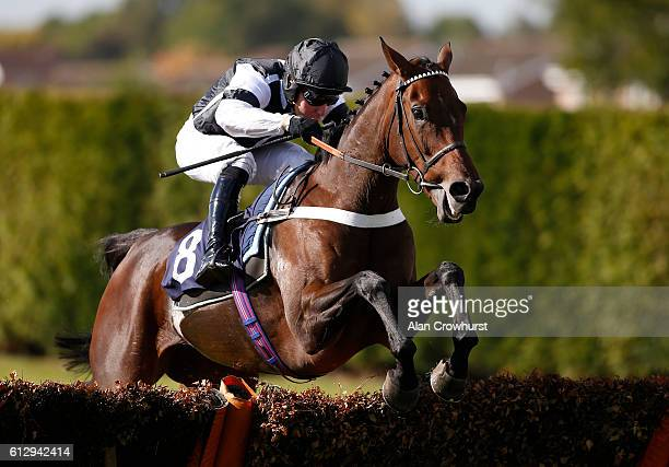 Andrew Tinkler riding Rather Be clear the last to win The bet365/British Stallion Studs EBF 'National Hunt' Novices' Hurdle Race at Hereford...