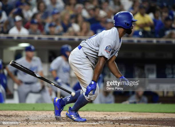 Andrew Toles of the Los Angeles Dodgers hits a single during the eighth inning of a baseball game against the San Diego Padres at PETCO Park on July...