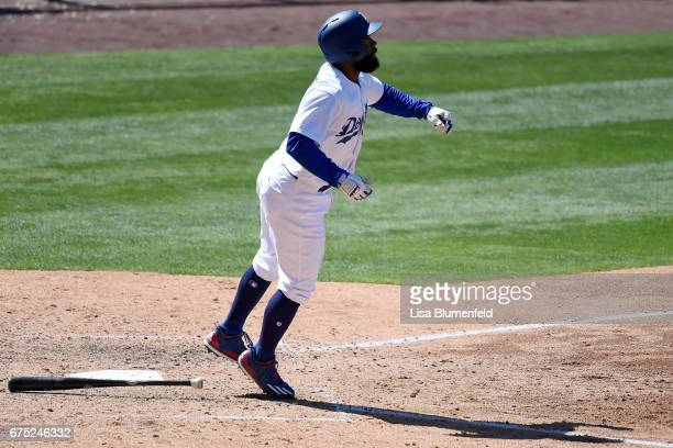 Andrew Toles of the Los Angeles Dodgers hits a three run homerun in the sixth inning against the Philadelphia Phillies at Dodger Stadium on April 30...