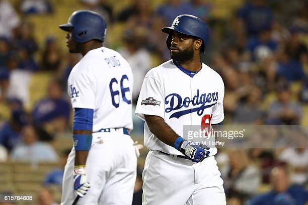 Andrew Toles of the Los Angeles Dodgers looks on against the Chicago Cubs in game four of the National League Championship Series at Dodger Stadium...