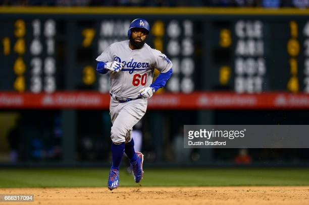 Andrew Toles of the Los Angeles Dodgers rounds the bases after hitting a fifth inning solo home run against the Colorado Rockies at Coors Field on...
