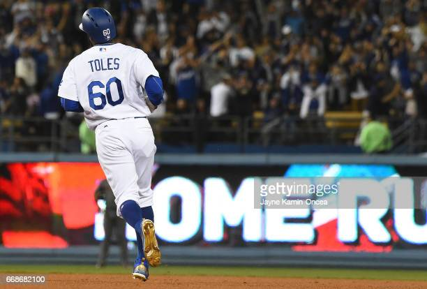 Andrew Toles of the Los Angeles Dodgers rounds the bases after a two run home run in the eighth inning of the game against the Arizona Diamondbacks...
