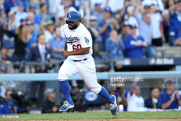 Andrew Toles of the Los Angeles Dodgers scores a run on a Chase Utley RBI single in the eighth inning during Game 4 of NLDS against the Washington...