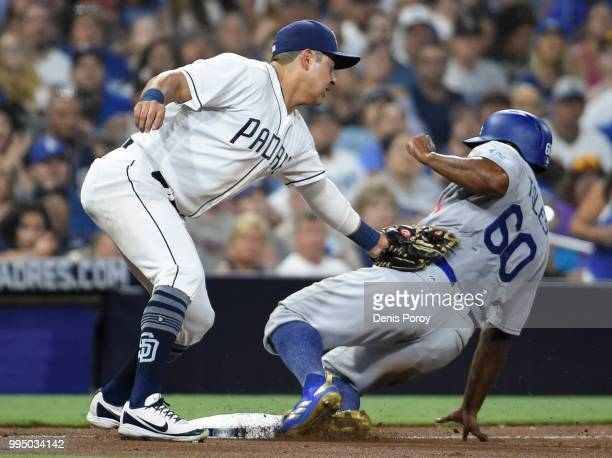 Andrew Toles of the Los Angeles Dodgers slides into third base ahead of the tag of Christian Villanueva of the San Diego Padres during the eighth...