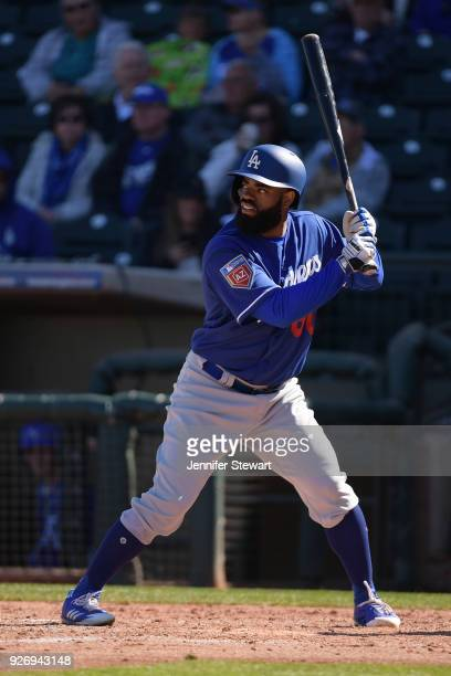 Andrew Toles of the Los Angeles Dodgers stands at bat in the spring training game against the Kansas City Royals at Surprise Stadium on February 24...