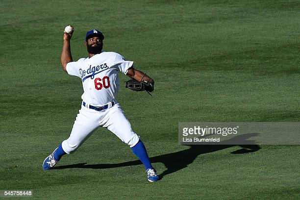 Andrew Toles of the Los Angeles Dodgers throws the ball to second base in the fifth inning against the San Diego Padres at Dodger Stadium on July 9...