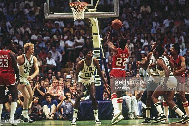 Andrew Toney of the Philadelphia 76ers shoots against Robert Parish of the Boston Celtics during a game played circa 1980 at Boston Garden in Boston...
