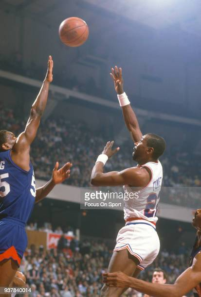 Andrew Toney of the Philadelphia 76ers shoots over Albert King of the New Jersey Nets during an NBA basketball game circa 1982 at The Spectrum in...