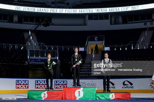 Andrew Torgashev of the United States Alexey Erokhov of Russia and Igor Efimchuk of Russia pose in the Junior Men's medal ceremony during day three...