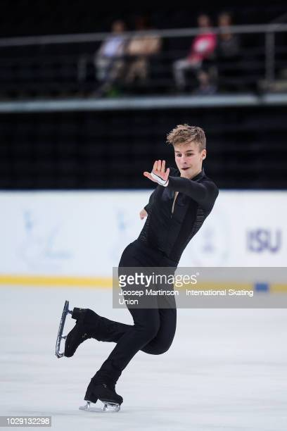 Andrew Torgashev of the United States competes in the Junior Men's Free Skating during day three of the ISU Junior Grand Prix of Figure Skating Amber...