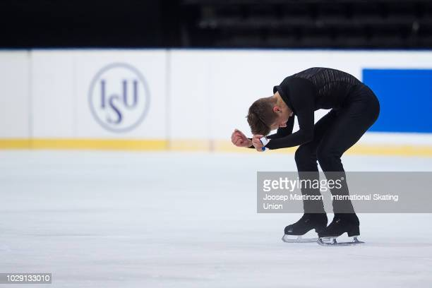 Andrew Torgashev of the United States reacts in the Junior Men's Free Skating during day three of the ISU Junior Grand Prix of Figure Skating Amber...