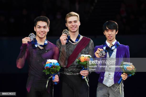 Andrew Torgashev of the USA Alexei Krasnozhon of the USA and Mitsuki Sumoto pose on the podium after competing in the junior men free skating during...