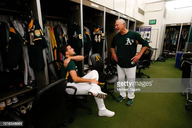 Andrew Triggs and Gil Patterson of the Oakland Athletics talk in the clubhouse prior to the game against the Toronto Blue Jays at the Oakland Alameda...