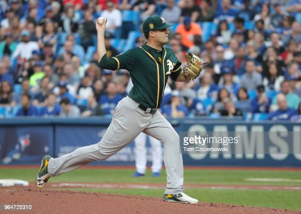 Andrew Triggs of the Oakland Athletics delivers a pitch in the first inning during MLB game action against the Toronto Blue Jays at Rogers Centre on...