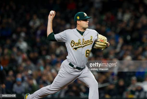 Andrew Triggs of the Oakland Athletics delivers against the Seattle Mariners in the third inning at Safeco Field on April 13 2018 in Seattle...